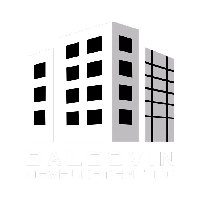 2 point perspective of 3 buildings. The front left one has 3 windows. The front middle one has 2 columns of 4 windows. The front right of the same building has 4 windows. The 3rd right is a grid of windows. The Baldovin Development Company text below completed their black and white logo.
